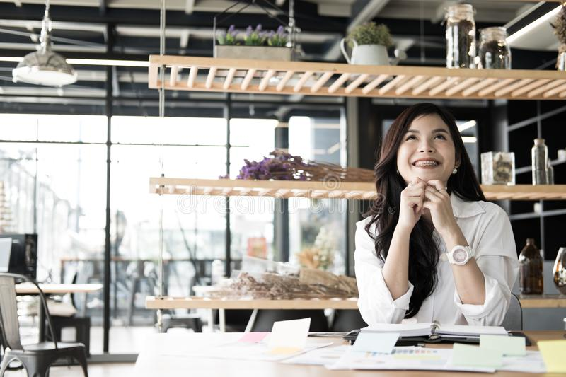 start up woman feeling happy at office. freelance female entrepreneur glad with successful project. businesswoman working at work stock photography