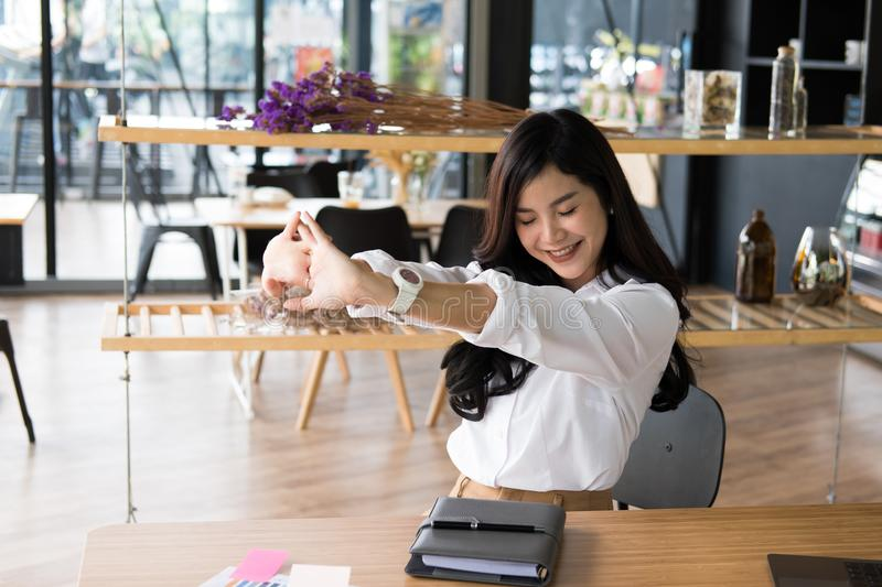 start up woman feeling happy at office. freelance female entrepreneur glad with successful project. businesswoman relaxing stock photos