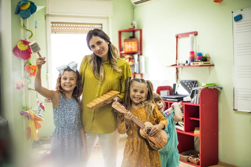 Started new class with music. Children in preschool stock image