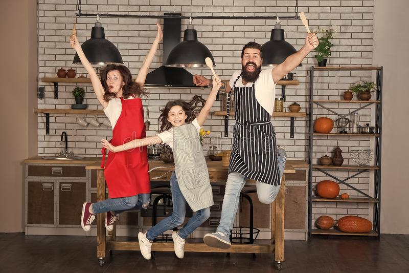 Starting day. Happy family in kitchen. Mother and father with little girl. Family day. Little girl with parents. Father royalty free stock image