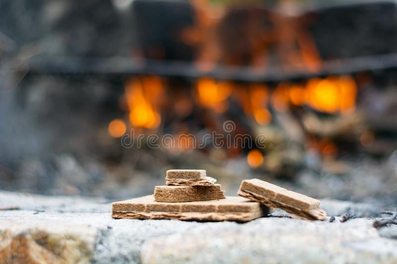 Starting kindling for a fire in the background of a flame royalty free stock images