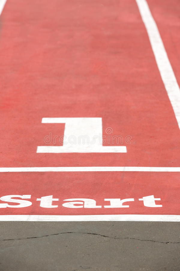 Starting line with number. On athletic stadium royalty free stock image