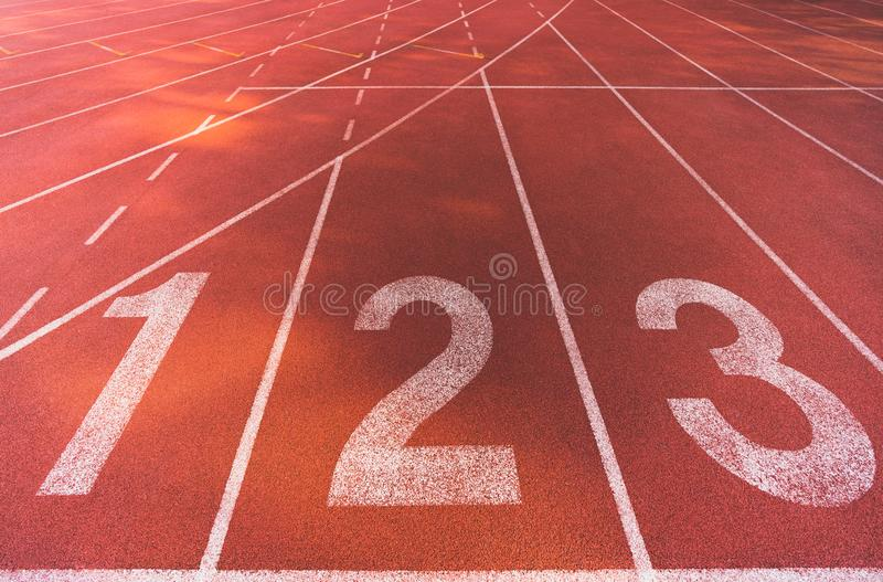 Starting line position of running track background texture, lane number 1, 2, 3. Business competitiveness conceptual royalty free stock photos