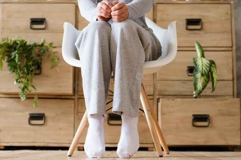 Start day apprehension man sit chair tiptoed. Starting new day with apprehension. Man sitting in chair with fists on knees. Tiptoed feet royalty free stock photos