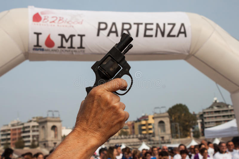 Starting pistol at the Innovation Running in Milan, Italy stock photography