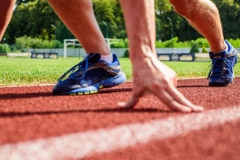 Starting point. Runner ready to go close up. Ready steady go concept. At the beginning of great sport career. Hand touch stock photography