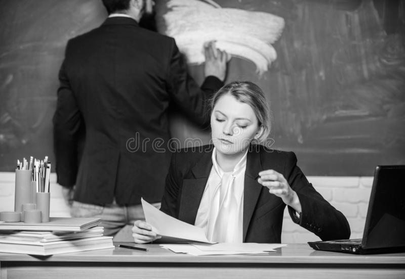 Starting to learn more. businessman and secretary. paper work. office life. business couple use laptop and documents royalty free stock images