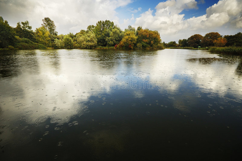 Starting to Rain. Raindrops starting to fall in one of the lakes of Park Delftse Hout, The Netherlands stock images