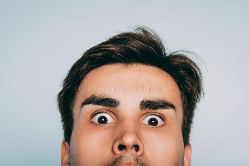 Startle crazy eccentric whimsical man face peek stock images