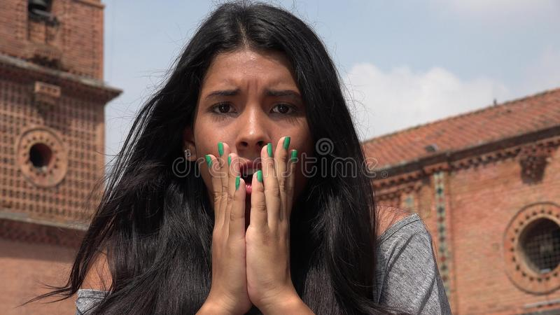 Startled People In Shock. Young attractive teen hispanic girl royalty free stock photos