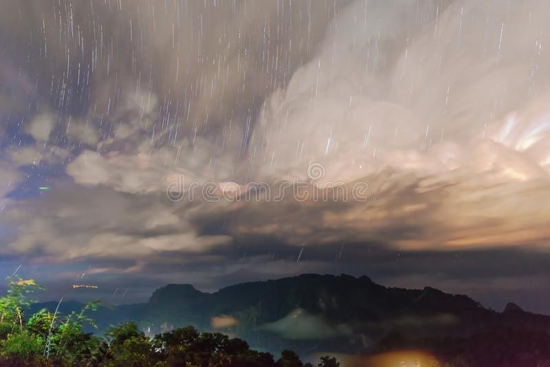 Startrail with Mountain view with foggy environment stock images
