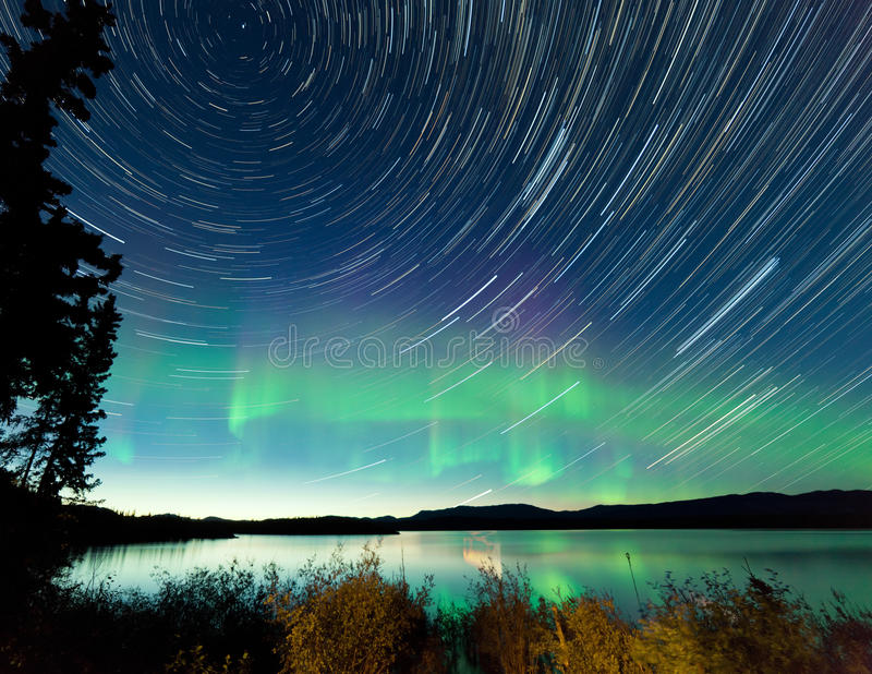Startrails Northern Lights display Lake Laberge royalty free stock photos