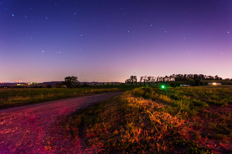 Startrails over a country road at night, in rural York County, P royalty free stock photo