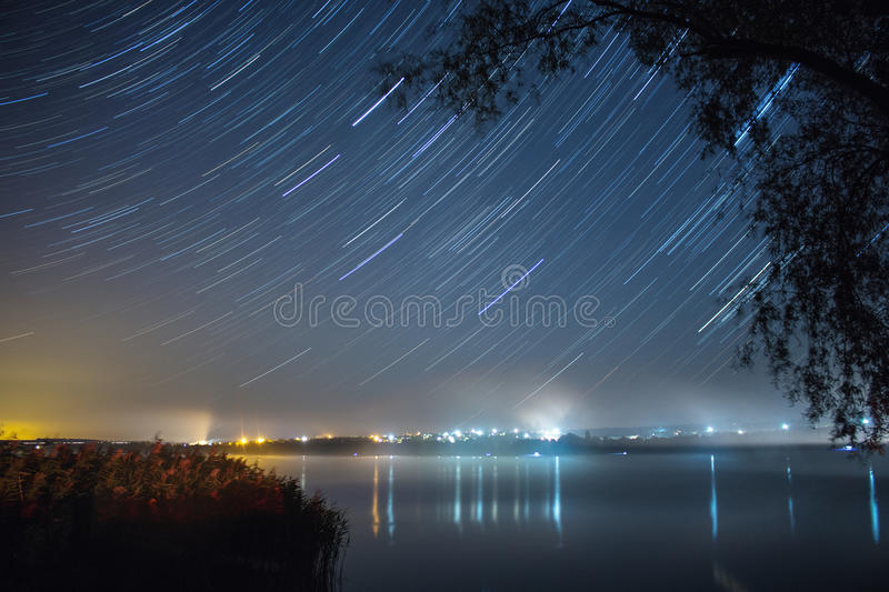 Startrails over the lake royalty free stock photo