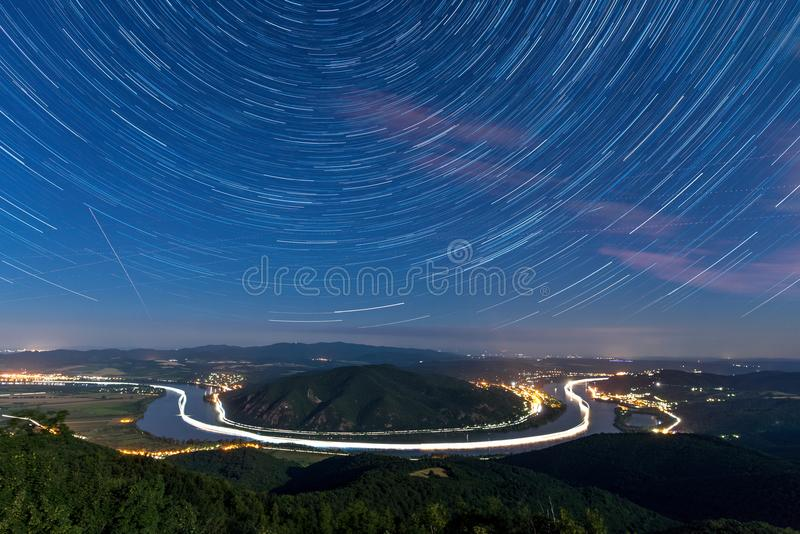 Startrails over a river bend. In Hungary stock photo
