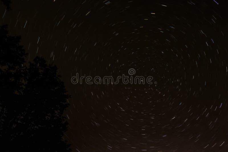 Startrails vortex in the night sky around North star. Startrails vortex around North Star in the sicilian night sky stock photos