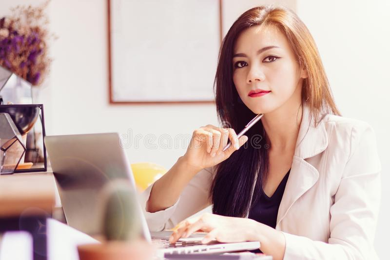 Startup business in Asia concept. focused young Asian business w stock photography