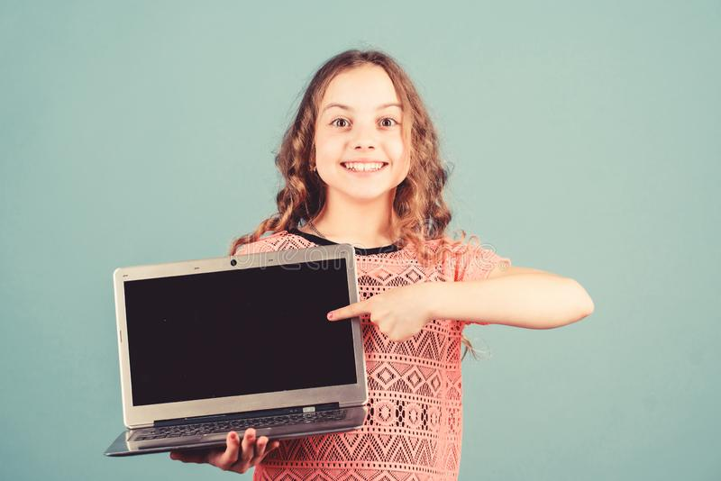 Startup business. child development in digital age. Play internet surfing. happy little girl with notebook. home. Schooling education. shopping online. school stock image
