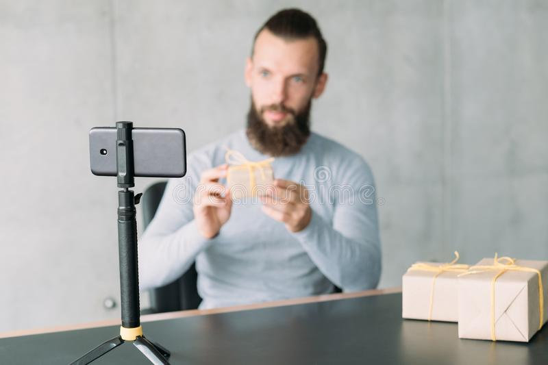 Startup business coaching guy smartphone goods royalty free stock images