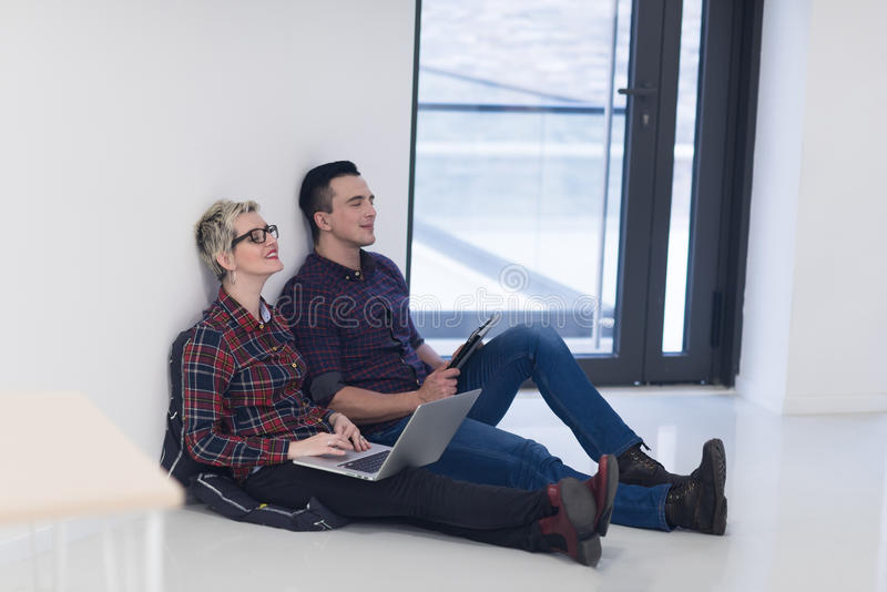 Startup business, couple working on laptop computer at office. Startup business and new mobile technology concept with young couple in modern bright office stock photos