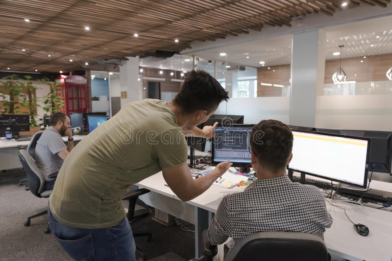 Startup business people group working as team to find solution stock image