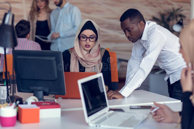 Startup business people group working everyday job at modern office. Tech office, tech company, tech startup, tech team. royalty free stock images