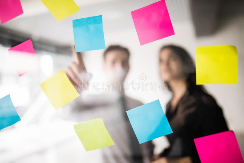 Startup business people two working everyday job at modern office with stickers. Tech office, tech company, tech startup, tech tea royalty free stock photos