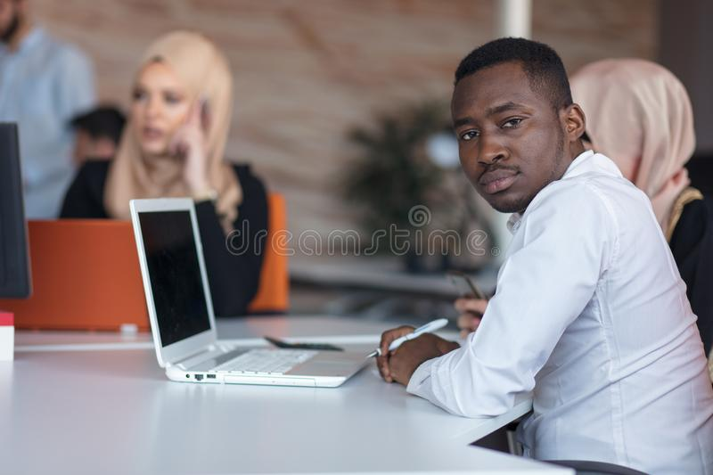 Startup business people group working everyday job at modern office. Tech office, tech company, tech startup, tech team. royalty free stock image