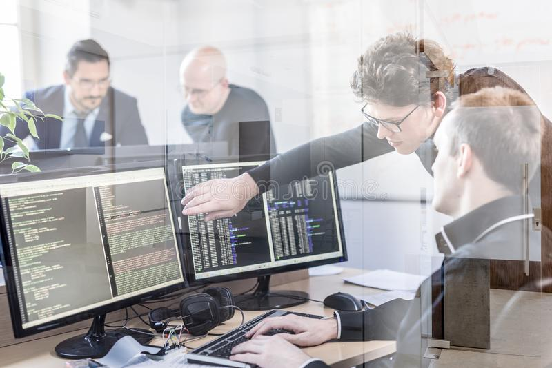 Startup business problem solving. Software developers working on desktop computer. Startup business and entrepreneurship problem solving. Young AI programmers stock photo