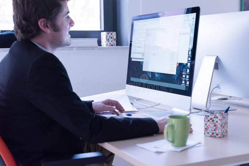 Startup business, software developer working on computer stock photo
