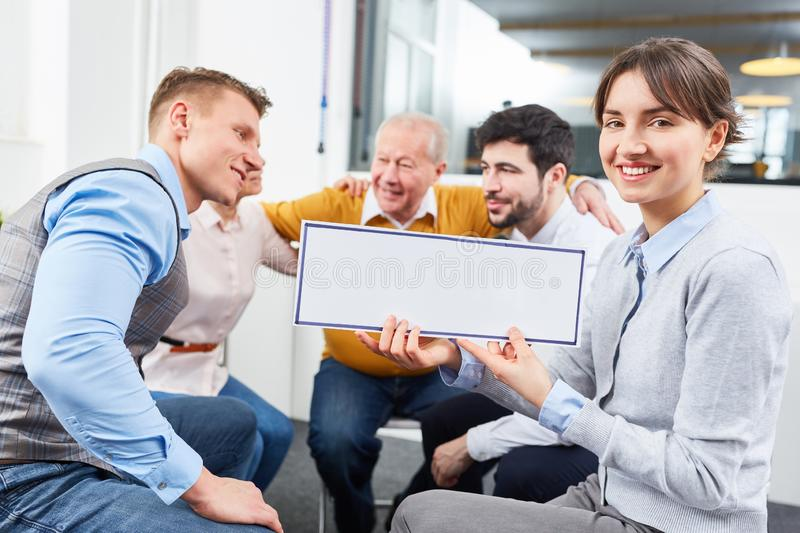 Business team group in seminar with sign royalty free stock images