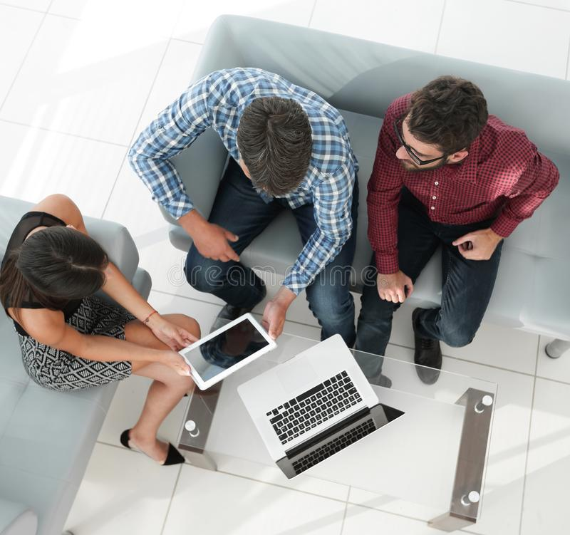 View from above of a group of people working with gadgets royalty free stock images