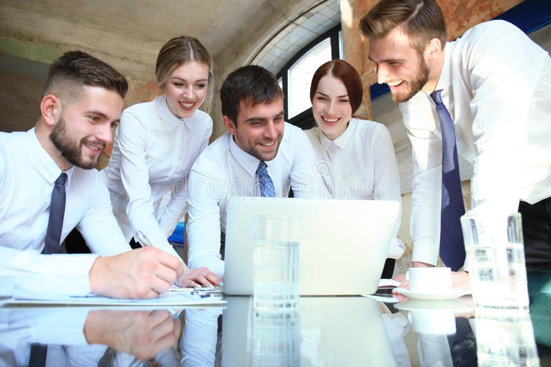 Startup business team on meeting in modern bright office interior and working on laptop stock photo