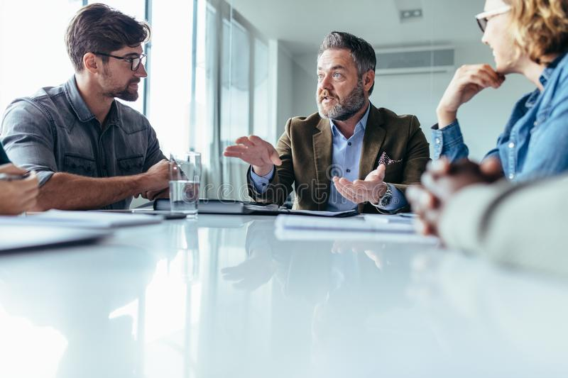 Businessman explaining new business ideas to colleagues royalty free stock photography