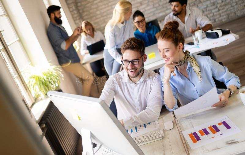 Startup business team on meeting in modern bright office interior brainstorming, working on computer. Startup business team on meeting in modern office interior royalty free stock photo