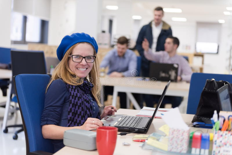 Startup business, woman working on laptop stock photography
