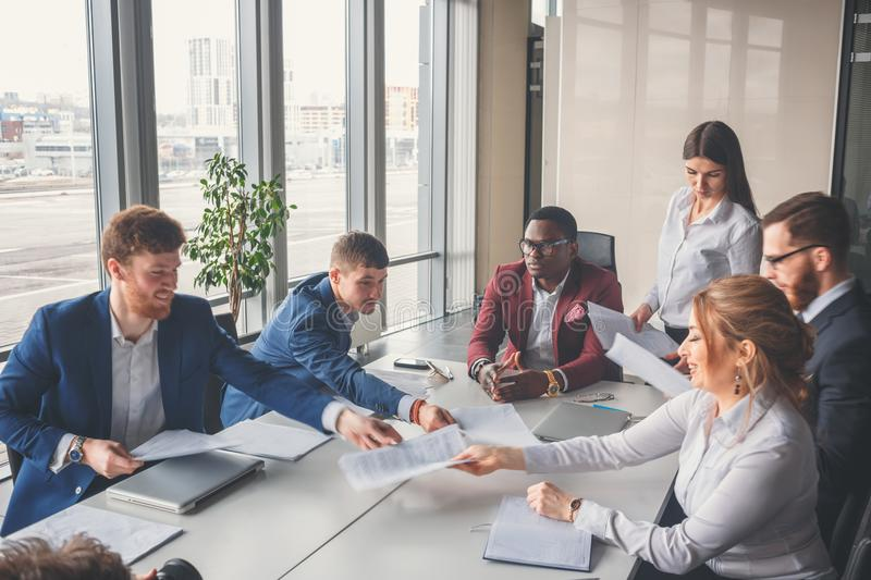 Startup business, young creative people group entering meeting room stock image