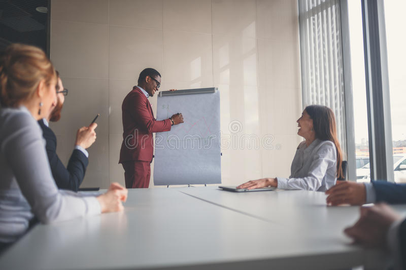 Download startup business young creative people group entering meeting room modern office interior stock