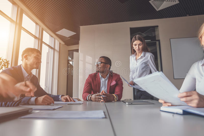 Startup business, young creative people group entering meeting room, motion blur, one man focused stock image