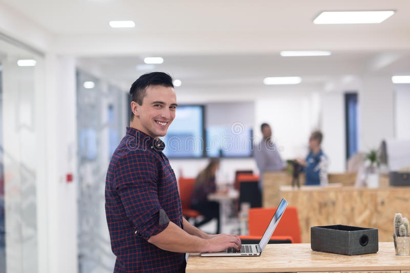 Startup business, young man portrait at modern office royalty free stock photos
