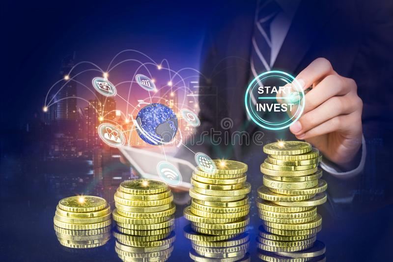 Startup button on a virtual screen touched by a businessman, Business man pointing at growth graph and business concept royalty free stock photo