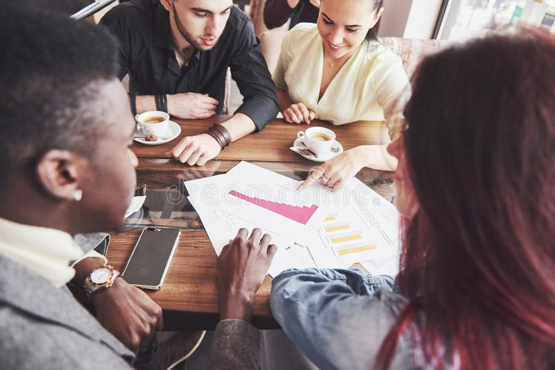 Startup Diversity Teamwork Brainstorming Meeting Concept. Business Team Coworkers Sharing World Economy Report Document royalty free stock photo