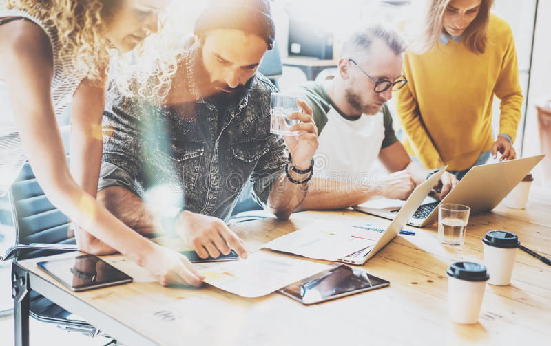 Startup Diversity Teamwork Brainstorming Meeting Concept.Business Team Coworkers Sharing World Economy Report Document royalty free stock photo
