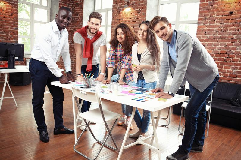 Startup Diversity Teamwork Brainstorming Meeting Concept.Business Team Coworkers Sharing World Economy Report Document royalty free stock photography