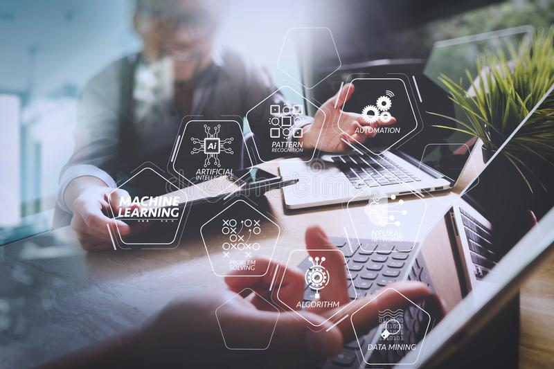 StartUp Programming Team. Website designer working digital table. Machine learning technology diagram with artificial intelligence (AI),neural network,automation stock photo