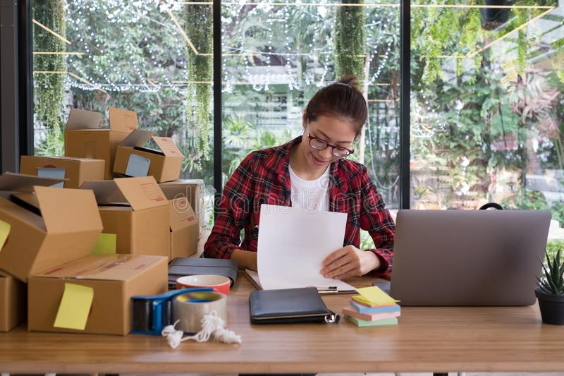 Startup small business owner working at workplace. freelance woman seller check product order to prepare for delivery to customer. Start up small business owner stock photo