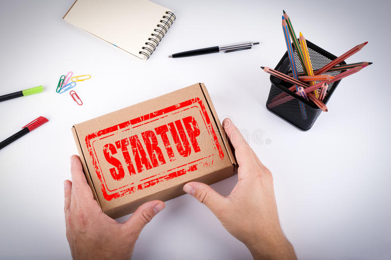 Startup stamp Business concept. Courier delivered box to the of. Fice stock photos