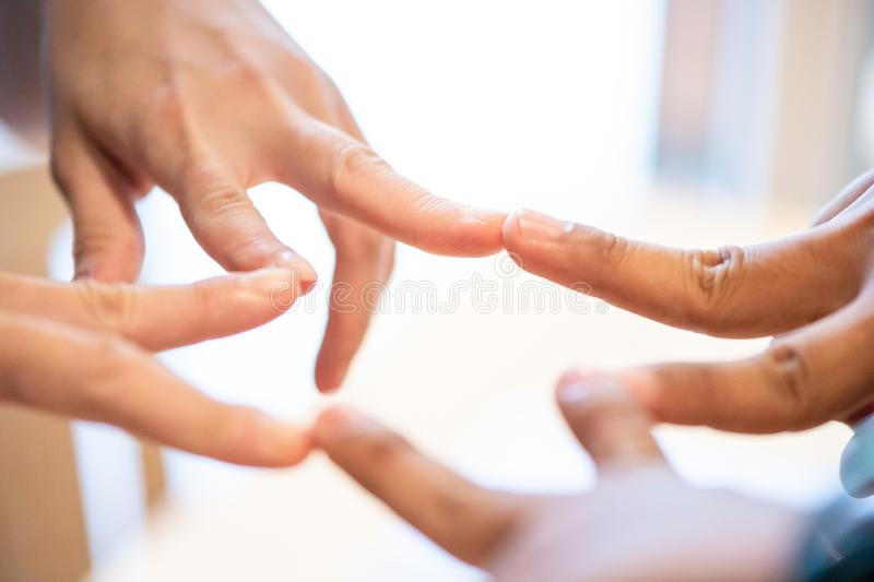 startup standing finger sign  together.business people joining for cooperation.startup show the finger sign of success with royalty free stock image