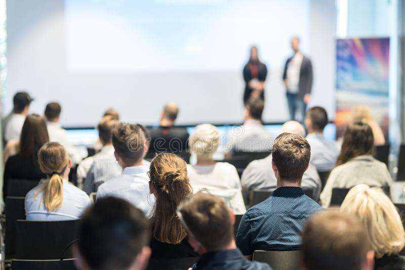 Business speakers giving a talk at business conference event. stock photography