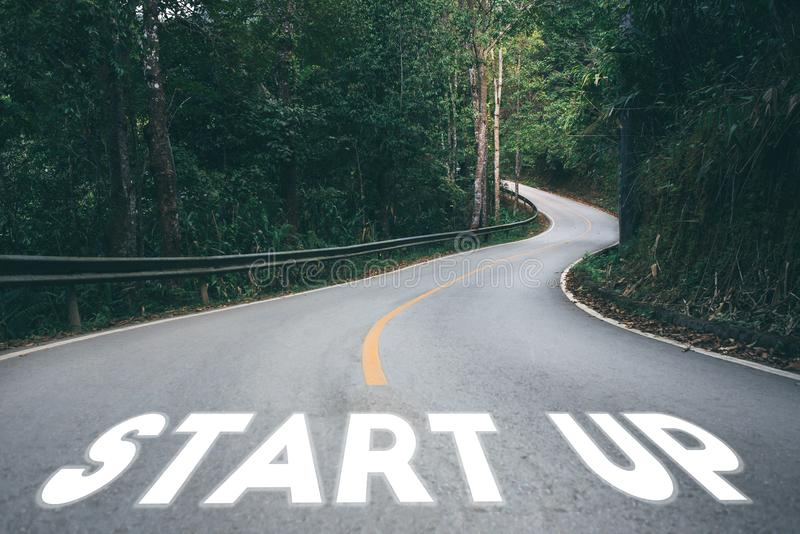 Startup to success business printed on road leading towards royalty free stock photos